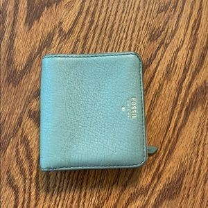 Gently used fossil blue wallet!
